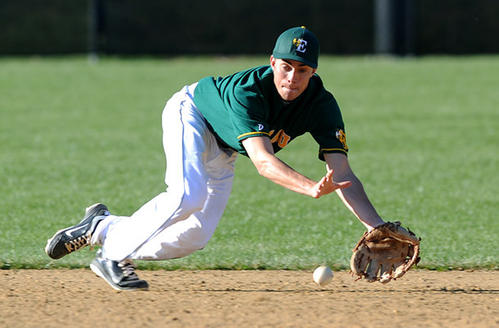 Emmaus' SS Taylor Jones  (4) dives for a ground ball up the middle during their game against Parkland High School Wednesday afternoon.