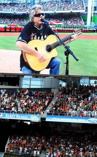 Jose Feliciano sings the national anthem during Marlins opening night at Marlins Park.