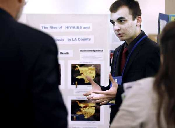 Clark Magnet High School senior Tigran Ghukasyan, 17, talks to judges about his study on HIV and Tuberculosis at the Los Angeles County Science Fair held at the Pasadena Convention.