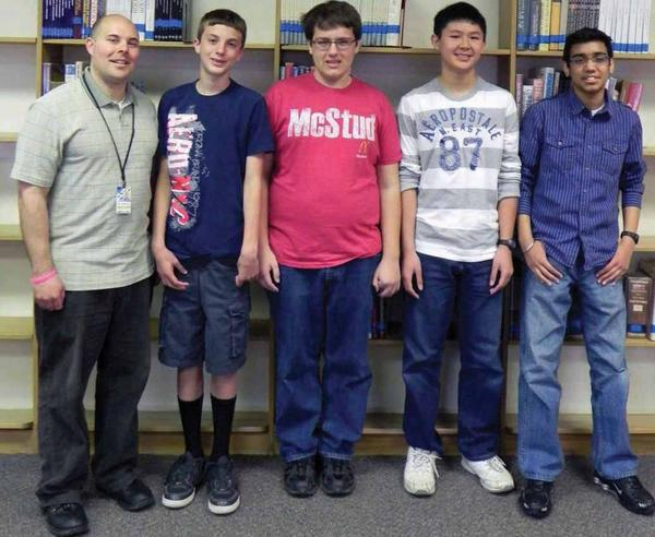 G-AMS Language Arts teacher and quiz bowl team coach Raymond Mowery, left, is shown with team members, from left, Jacob DeCarli, Cole Eberly, John Huynh and Navjit Singh.