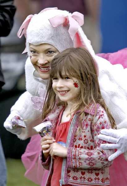 Matisse Anderson, 4 of Los Angeles, poses with Easter Bunny Rowena Emmett during the Annual Dilbeck Real Estate Easter in the Park at Memorial Park in La Canada Flintridge in 2011. Festivities included egg hunts, hat parade, games, prizes and a stage show.