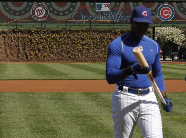 Alfonso Soriano comes in from the batting cage during a pre-opening day workout for the Chicago Cubs at Wrigley Field.