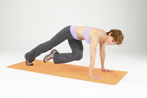 Keep your hips low and shoulders above hands.