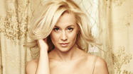 "<span style=""font-size: small;"">Kellie Pickler will return to the television show where it all began - American Idol. She will sing ""Where's Tammy Wynette?"" which is featured on her album 100 Proof, and plans to bring her country roots to the stage. ""As soon as that lick comes in – that guitar lick comes in. And the first line is, 'I stay torn between killing him and loving him.' Right off the bat you know, I'm about to listen to a country record."" Kellie will take the stage during American Idol's live results show on FOX.</span>"