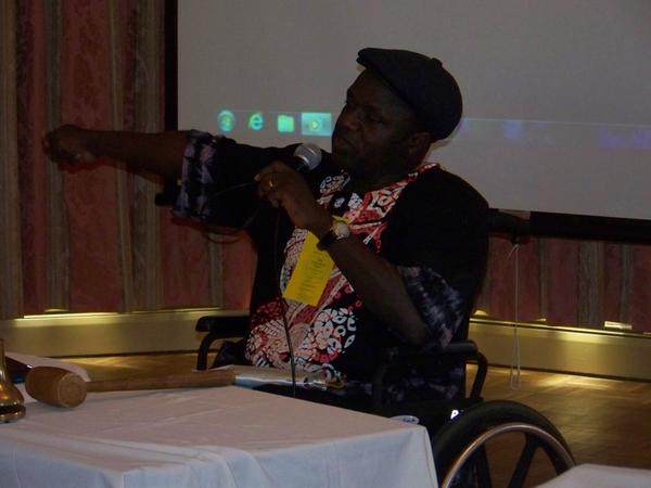 Ayuba Gufwan, a Nigerian polio survivor and founder of the Handicapped Advocacy and Rehabilitation Center in Nigeria, speaks Wednesday in Petoskey about how his organization is helping other survivors.