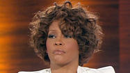 Whitney Houston was submerged in bathwater for nearly an hour before a personal assistant found her dead in the Beverly Hilton Hotel, an autopsy report released Wednesday said.