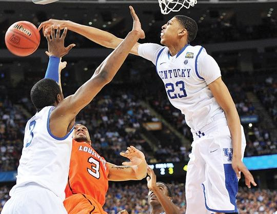 Kentucky center Anthony Davis blocks a shot against Louisville in the national semifinals last weekend in New Orleans. Davis set a school record for blocks with 186 in one season. He was  part of the ¿Kentucky Effect¿ that overwhelmed opponents this season.