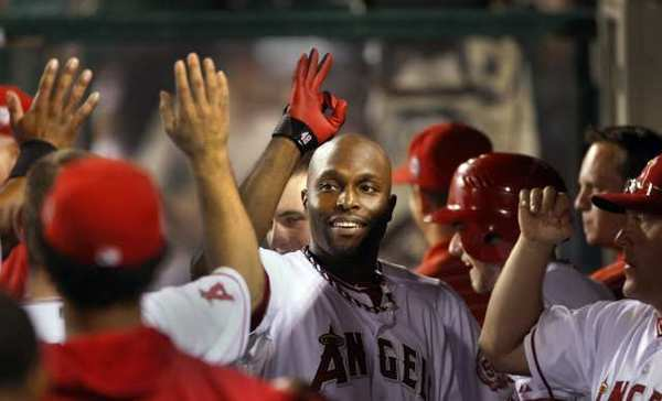 The Angels' Torii Hunter is congratulated after hitting a home run against the Chicago White Sox last summer.