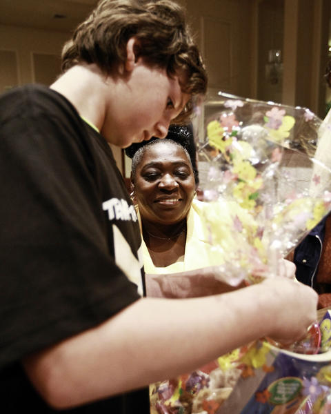 """Essie """"Big Momma"""" Reed, of Fort Lauderdale, and Sam Angel, 11, of Weston, make Easter baskets during Temple Beth Emet's 10th Annual Mitzvah Day."""