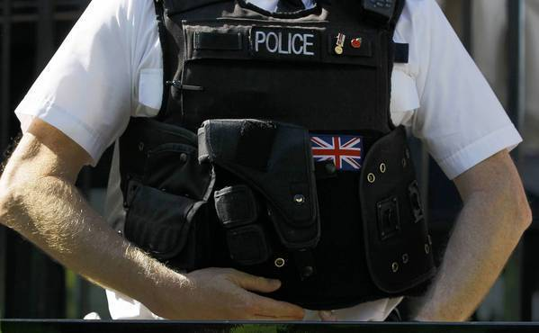 A police officer keeps watch in Westminster in London. The British government is accused of trying to turn the country into a police state with plans to conduct some trials in secret and allow authorities to track the communications of anyone.
