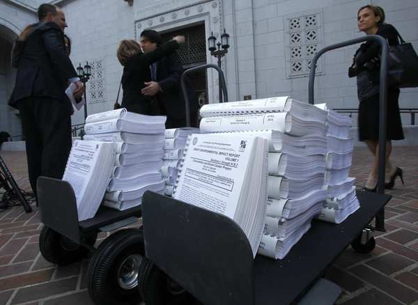 Anschutz Entertainment Group's environmental impact report for the proposed football stadium in downtown L.A. runs 10,000 pages and cost $27 million. Carts were needed to deliver it to City Hall.