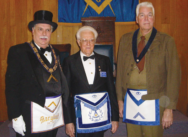 Glenn Haynes, center, received a 70-year pin from Gerald Piepiora, the worshipful deputy grand master of Masons for the Grand Lodge of Maryland, left. Also pictured is Jeff Stouffer.