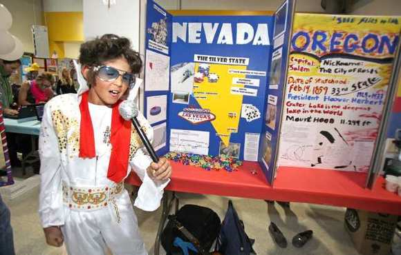 Fifth-grader Kevin Smith impersonates the iconic Elvis Presley in his Las Vegas heyday, a live version of his representation of the state of Nevada during the El Morro State Fair on Thursday. Kids presented reports on all 50 states with posters and costumes.