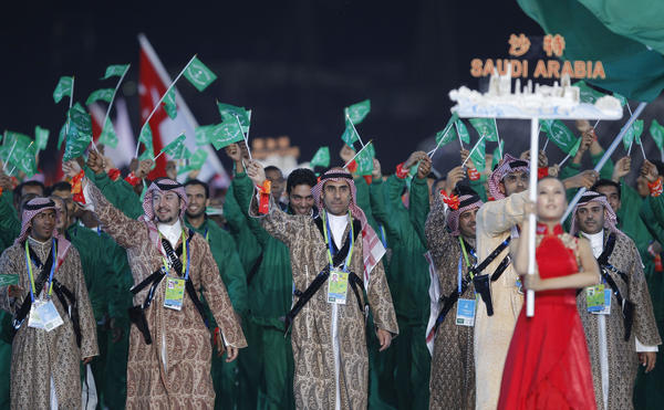 Athletes and officials from Saudi Arabia take part in the opening ceremony of the 16th Asian Games in Guangzhou.