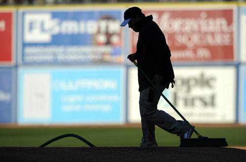 Lehigh Valley IronPigs' Field Maintenance Manager Paul Tumavitch manicures the pitchers mound prior to opening night against the Scranton/Wilkes-Barre Yankees at Coca-Cola Park Thursday.