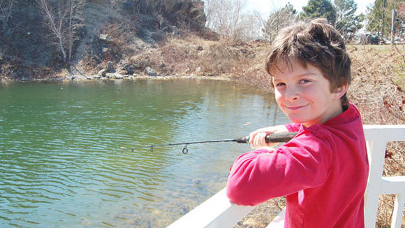 Mason McFadden, 9, of Petoskey, tries his hand at catching a trout in the lime kiln pond on Monday at Petoskey's waterfront. See a photo gallery at www.gaylordheraldtimes.com.
