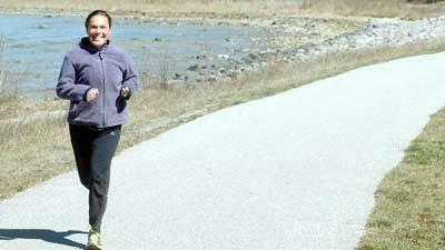 Charlevoix's Nicole Sterrett runs on a section of the Little Traverse Wheelway near Big Rock Point  one of her favorite routes to run in preparation for the upcoming Boston Marathon.