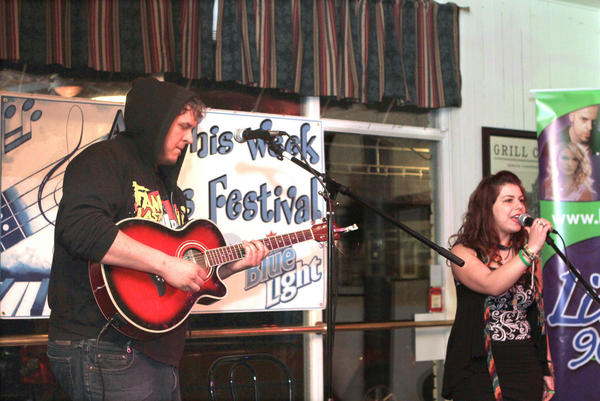 Randall Erno (left) and Kayla Cross of MEGAskyfish win the $150 first place award during the third annual Petoskey's Got Talent contest sponsored by City Park Grill.
