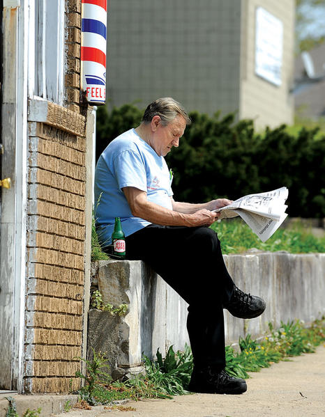 Lee Fox of Center Drive relaxes with a copy of The Winchester Sun and a cold Ale8 while waiting for his barber to return from lunch. Fox was enjoying the afternoon sunshine earlier this week outside Patrick¿s Barber Shop on East Washington Street.