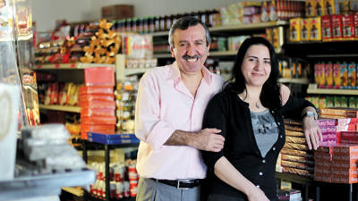 Turkish Family Market owners, Bahattin Kaymak, left, and Nuran Kaymak pose for a photo in their store in Ellicott City.