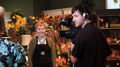 Cathy Klein, owner of the River Hill Garden Center, works with videographer Nate Smith to create a video to help market her business on meetlocalbiz.com.