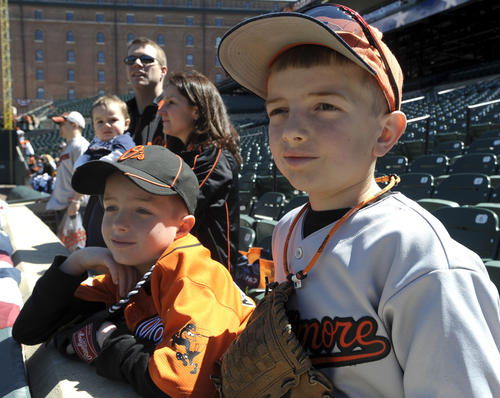 Owen Stanton, left, and his brother, Christian Stanton, await the start of batting practice for the O's.