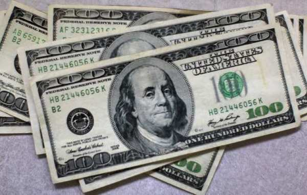 The federal budget deficit for the first half of the fiscal year is $53 billion less than it was in the same period a year ago, according to the Congressional Budget Office.