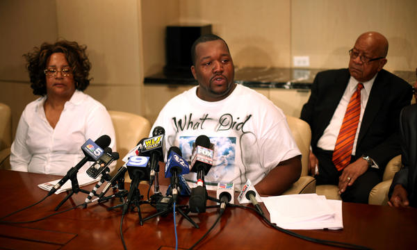 Martinez Sutton, 29, middle, brother of Rekia Boyd, a 22-year-old Chicago woman shot by a police officer, addresses the media while announcing a lawsuit against the city and the accused police officer.