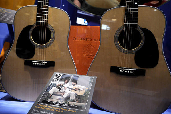 In the Martin Guitar museum Paul Saltzman's well-known photo of John Lennon and Paul McCartney playing matching D-28s shows the two Beatles in India where they wrote 42 songs that became The White Album. These are D-28 guitars.   Guitars that Rock is an exhibit in the Martin Guitar museum that is part of Rock Through the Valley.
