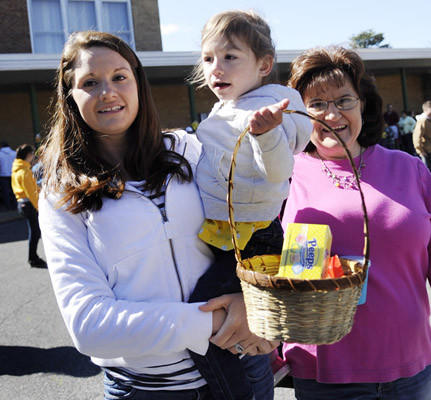 After the Easter Egg Hunt held at Palmer Township Elementary School Friday morning Johanna Reber of Woodbridge, Va., left, holds her daughter Hailey Reber, 2, as they go home with candy. They are visiting Hailey's grandmother and Johanna's mother Penny Diehl of Palmer Twp., right.