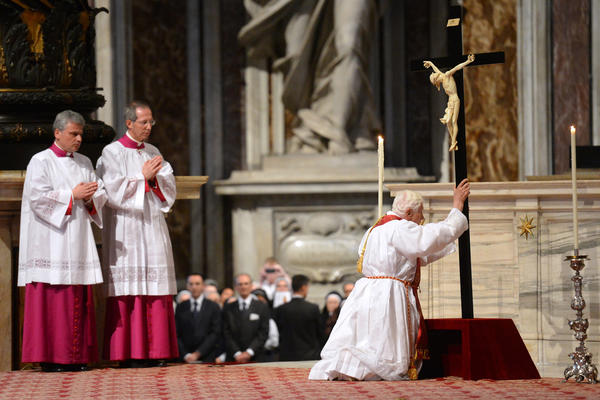 Pope Benedict XVI (R) holds the cross during the Celebration of the Lord's Passion on Good Friday on April 6, 2012 St Peter's basilica at The Vatican. Christians mark the crucifixion of Jesus Christ on Friday.