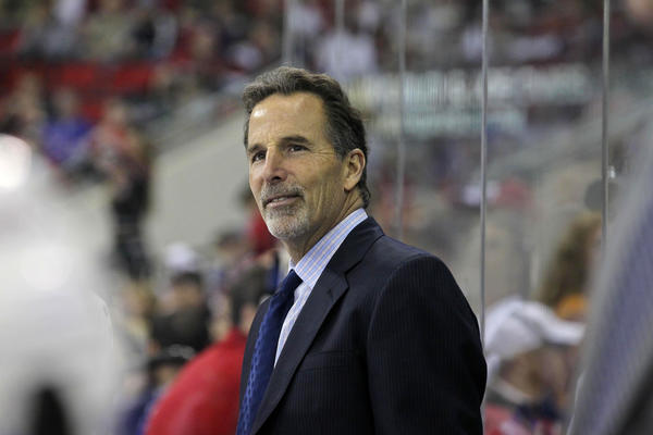 New York Rangers coach John Tortorella smiles during the game against the Carolina Hurricanes at the RBC center.