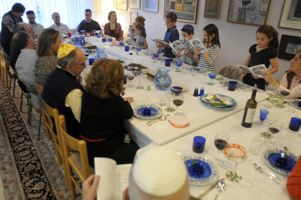 Generations of the family sit around the table to take part in the celebrations.