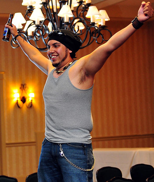 Daniel San shows off on the Charity Bachelor Auction runway Friday night at Fountain Head Country Club. As Bachelor #6, San garnered a winning bid of $200. Safe Place benefited from the event.