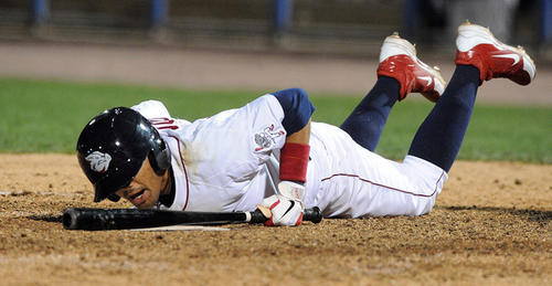 Lehigh Valley IronPigs' Andres Blanco (5) hits the ground to avoid a pitch during their game against the Scranton Wilkes-Barre Yankees at Coca-Cola Park in Allentown Friday night.