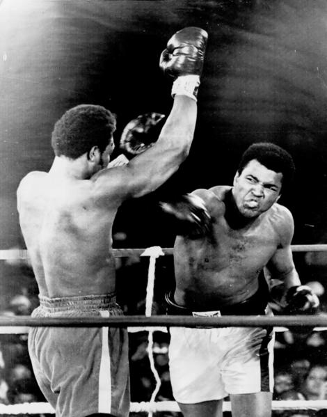 Muhammad Ali lands a right to George Foreman during his title bought in Kinshasa, Zaire, in 1974.