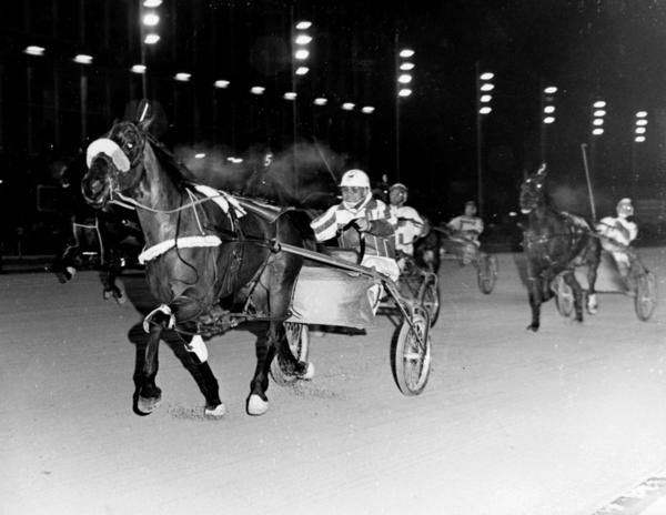 Muhammad Ali racing at Maywood Park in 1979. He set a world record by winning seven furlongs in 1:57, a world record for a half mile track.