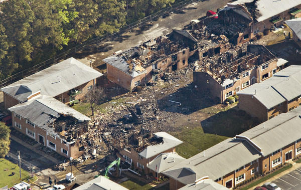 An F/A-18 Hornet navy jet sits on the ground after crashing into an apartment building Friday in Virginia Beach. Aerial photo was taken on Saturday.