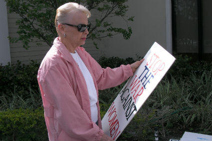 Democratic activist holds a sign protesting the so-called Republican war on women