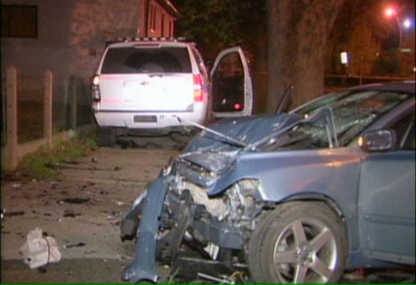 A 2008 Volvo that crashed head-on with the police SUV seen in the background. WGN-TV