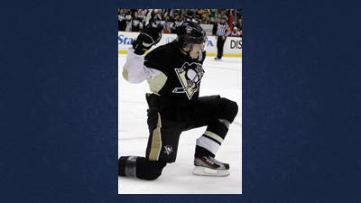 Pittsburgh Penguins Evgeni Malkin (71) celebrates his 50th goal of the season, in the second period of an NHL hockey game against the Philadelphia Flyers in Pittsburgh Saturday.