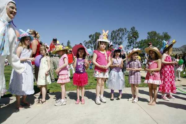 Children line up as they listen to the raffle prizes being called out during Easter in the Park, which took place at Memorial Park in La Canada on Saturday.