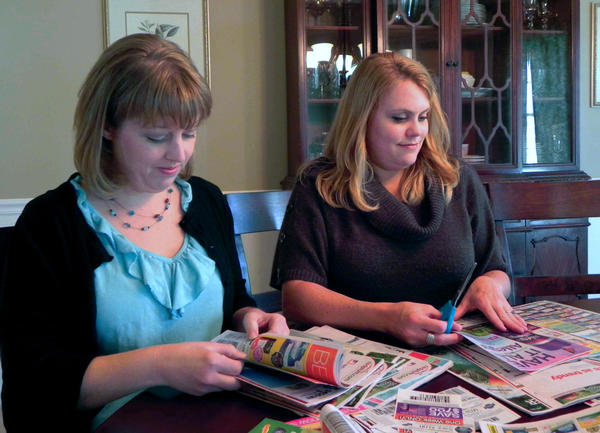 Millicent Frick, left, and Judy Chatterton go through stacks of coupons. Their website, www.2couponmoms.com, outlines specials and deals by grocery and drug stores and also offers advice on couponing.
