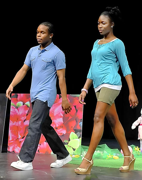Antoine Merriweather and Joan Watson model casual wear at the Black Student Unions fashion show at Kepler Center.