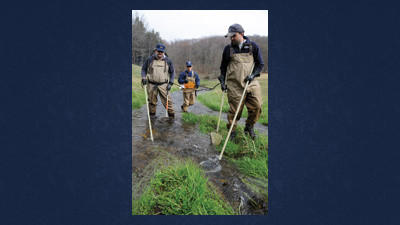 From left, Bob Ventorini, Richard Lorson and Mike Depew scan for fish as they survey a portion of Glades Run near High Point Lake on Wednesday. The Pennsylvania Fish and Boat Commission employees were conducting a trout residency survey prior to the start of the season on April 14.
