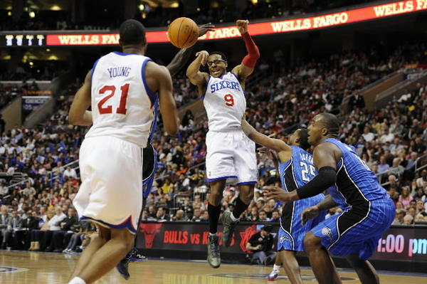 Philadelphia 76ers forward Andre Iguodala (9) passes the ball to forward Thaddeus Young (21) during the third quarter against the Orlando Magic at the Wells Fargo Center on Saturday, April 7, 2012.