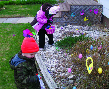 Lexy Becker gathers Easter eggs with her younger brother, Nicholas at their home in Aberdeen on Saturday. Lexy, who recently had a bone marrow transplant in Minneapolis, returned to Aberdeen for the Easter weekend. She is wearing a mask because her immune system is still weakened. Photo courtesy of Melissa Becker