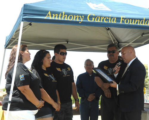 Brawley Mayor George Nava (right) presents the Garcia family with recognition from the city Saturday during the ceremony for Anthony Garcia at Meserve Park in Brawley. Councilman Sam Couchman is in the background.