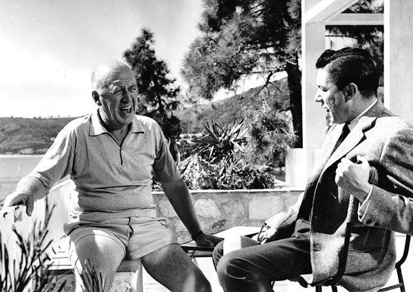 "Mike Wallace, right, talks with film producer Otto Preminger during a visit to the French Riviera for an episode of the ABC program ""The Mike Wallace Interview."""