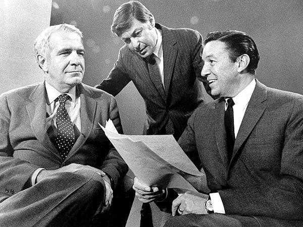 "Mike Wallace, right, meets with his co-host on ""60 Minutes,"" Harry Reasoner, left, and the program's creator, Don Hewitt."